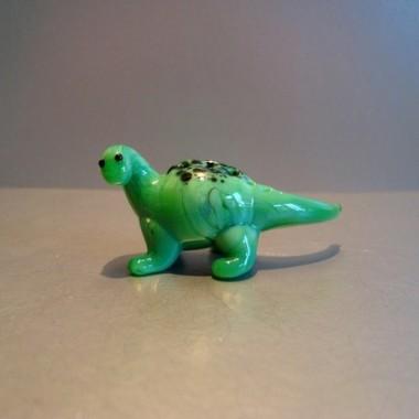 Dinosaure vert en verre