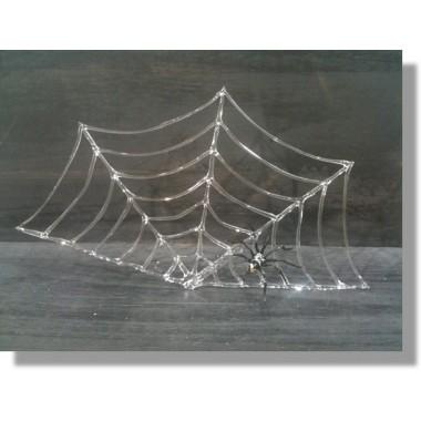 Araignée en verre sur sa toile