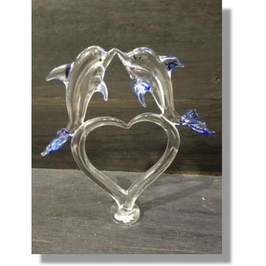 Couple de dauphin sur un coeur en verre
